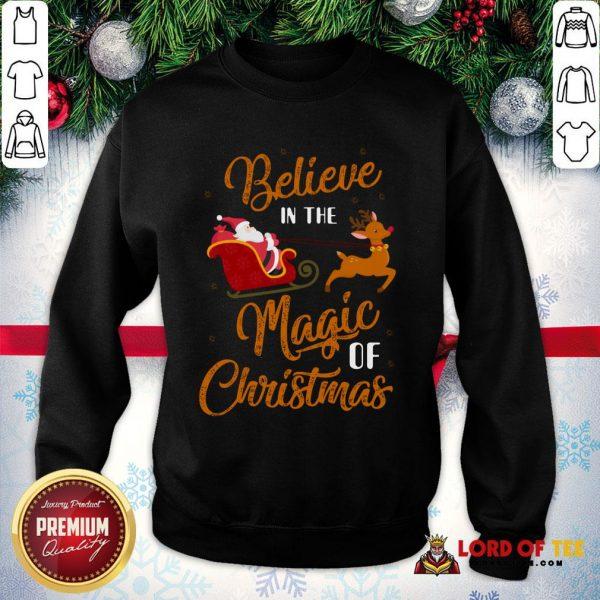 Nice Believe In The Magic Of Christmas Santa Claus Riding Reindeer SweatShirt
