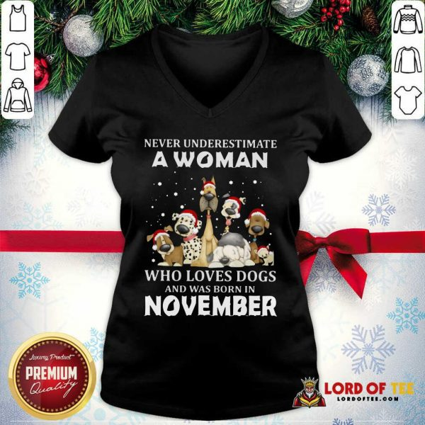 Never Underestimate A Woman Who Loves Dogs And Was Born In November Christmas V-neck-Design By Lordoftee.com